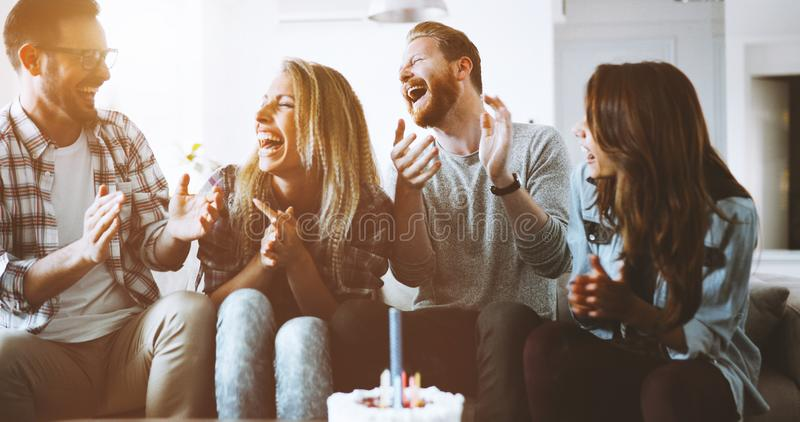 Young group of happy friends celebrating birthday. With cake royalty free stock photo