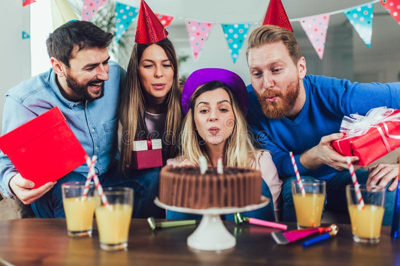 Group of happy friends celebrating birthday at home and having fun royalty free stock photos