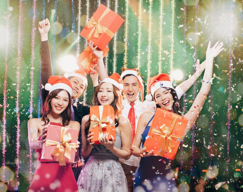 Young group having fun in christmas party royalty free stock photography
