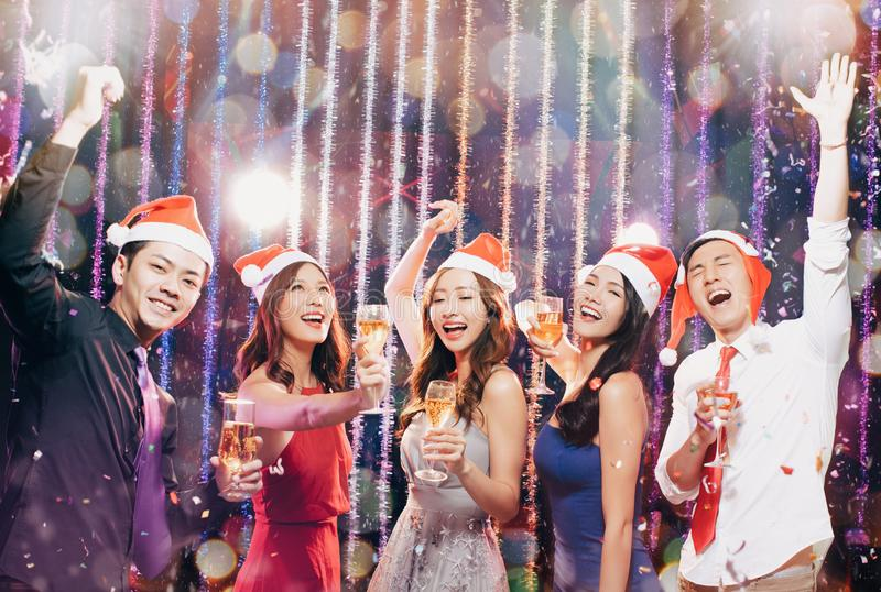 Young group having fun in christmas party stock photos