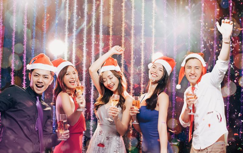 Young group having fun in christmas party royalty free stock photo