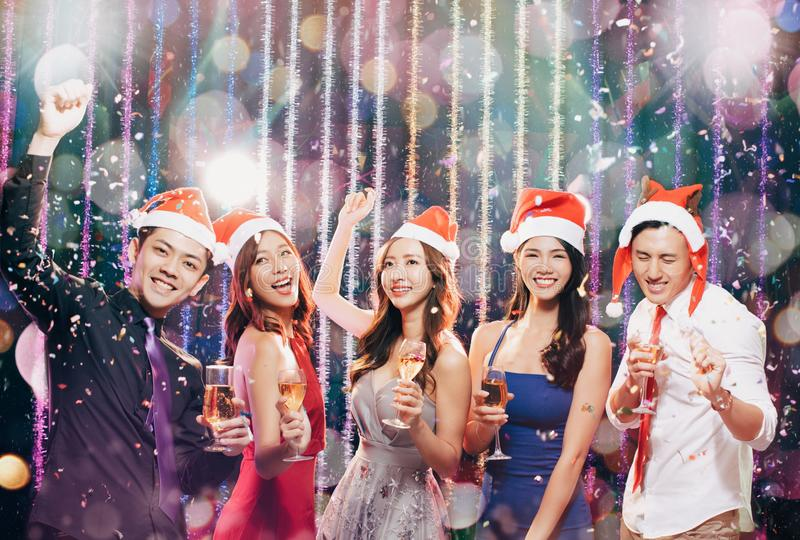 Young group having fun in christmas party stock image