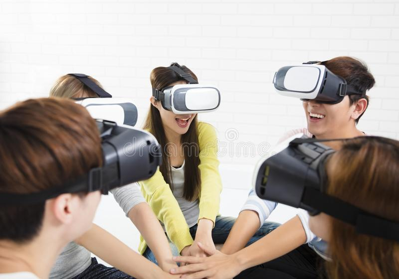 Young group having fun with new technology vr. Headset stock photo