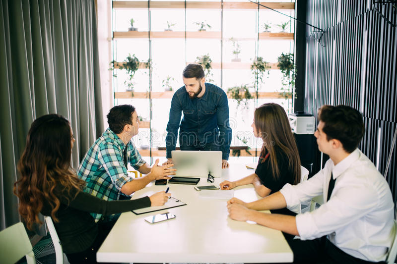 Young group of people discussing business plans. royalty free stock photo