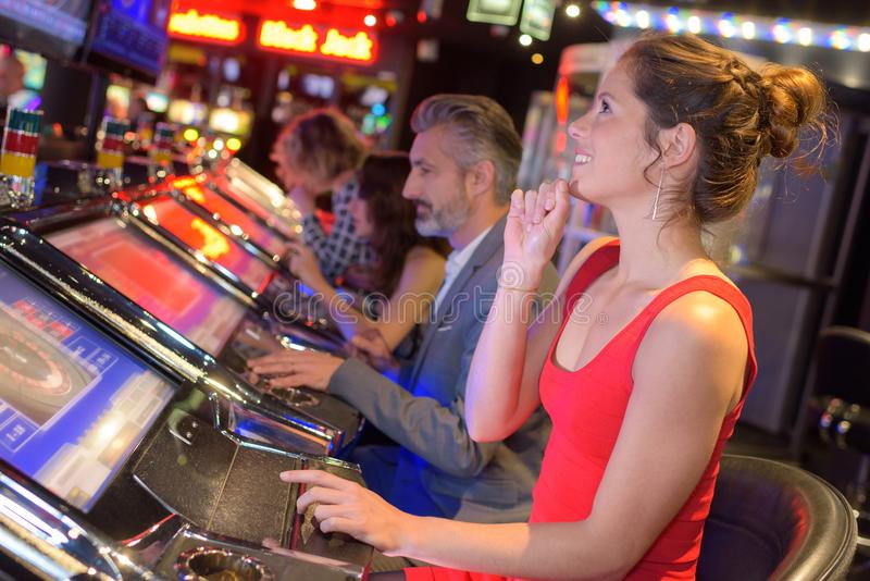 Young group people gambling in casino stock photography