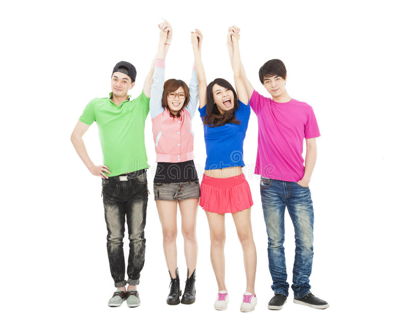 Young group standing together with hands up royalty free stock image