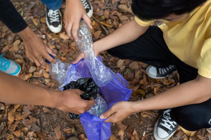 Young group volunteers cleaning rubbish royalty free stock photos