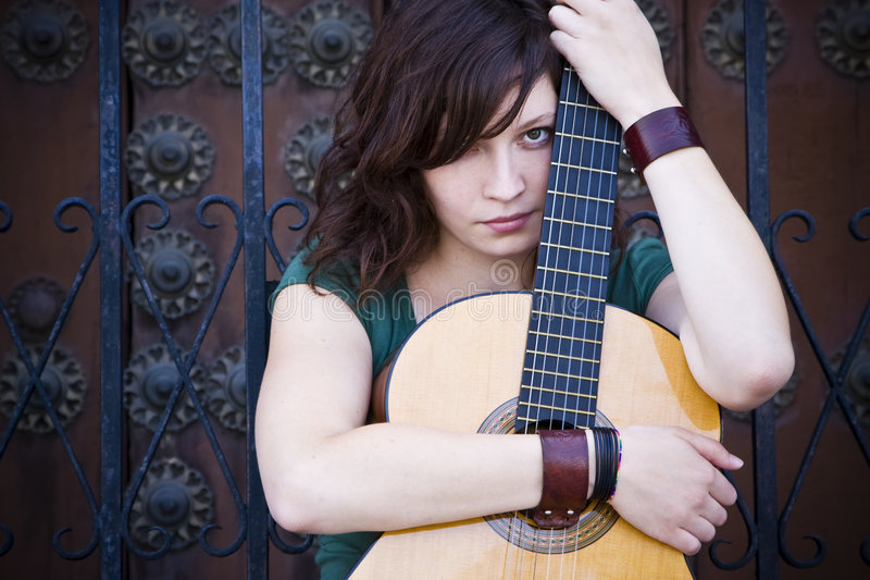 Download Young guitar performer stock image. Image of green, pensive - 7624627