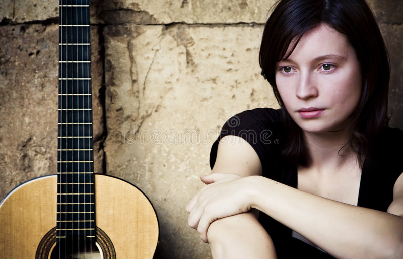Young guitarist royalty free stock photos