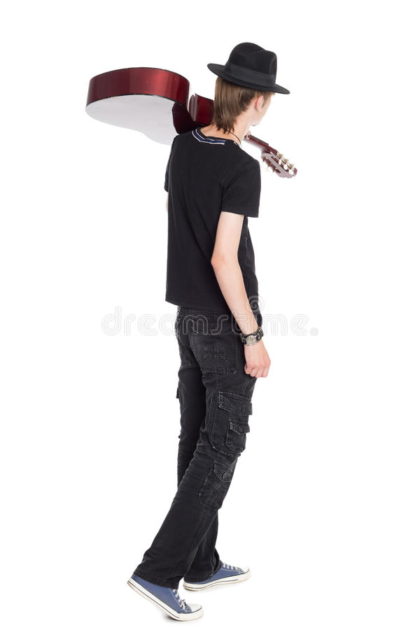 Young guitarist with guitar rear view royalty free stock image
