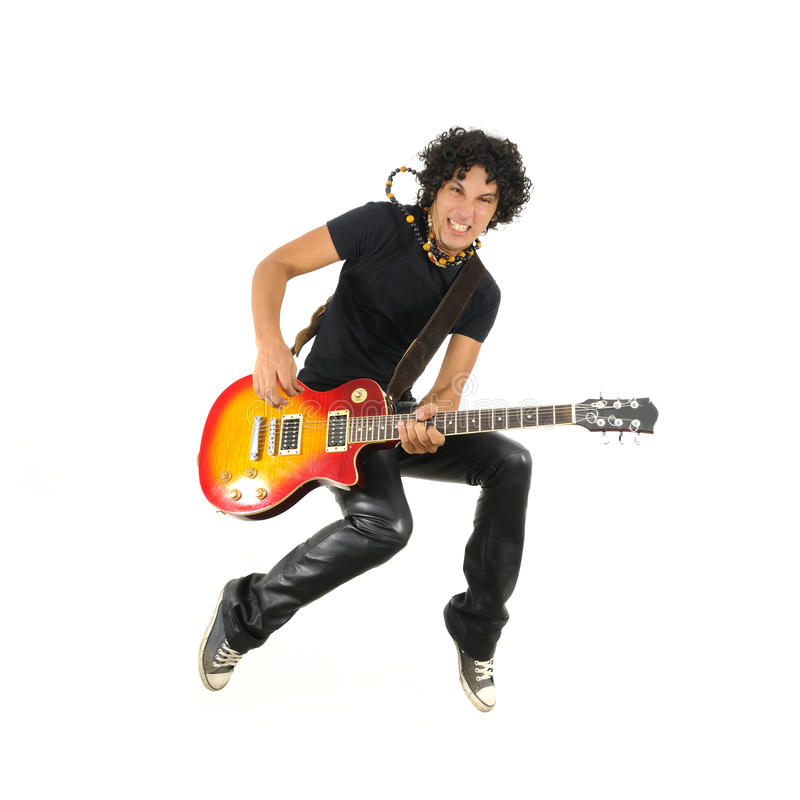 Young guitarist jumping isolated. Portrait of young trendy guy jumping with electric guitar isolated on white royalty free stock photo
