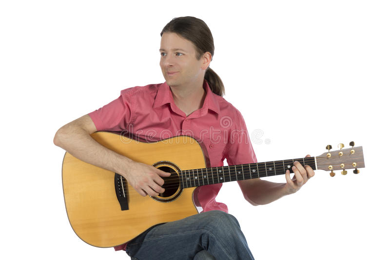 Young guitarist playing acoustic guitar royalty free stock photos