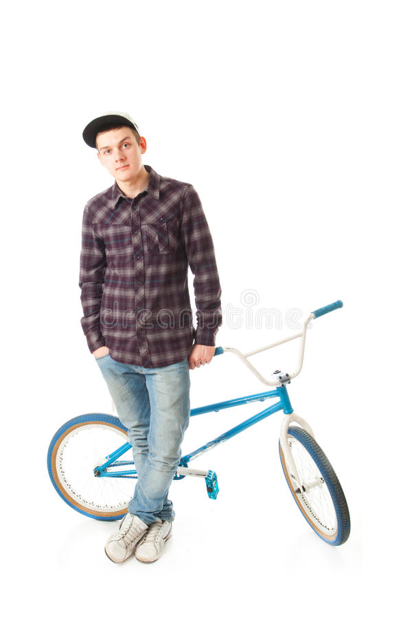 The young guy with a bicycle isolated on a white royalty free stock photos