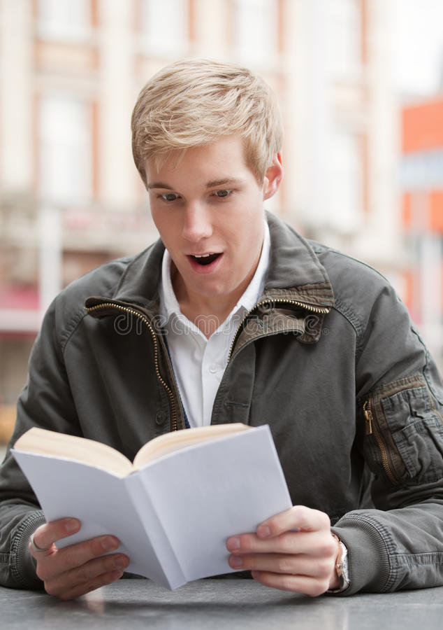 Download Young guy with book stock photo. Image of outdoor, casual - 11906512