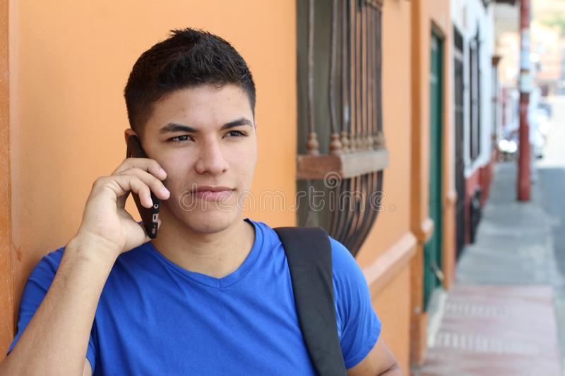 Young guy calling by phone outdoors stock photos