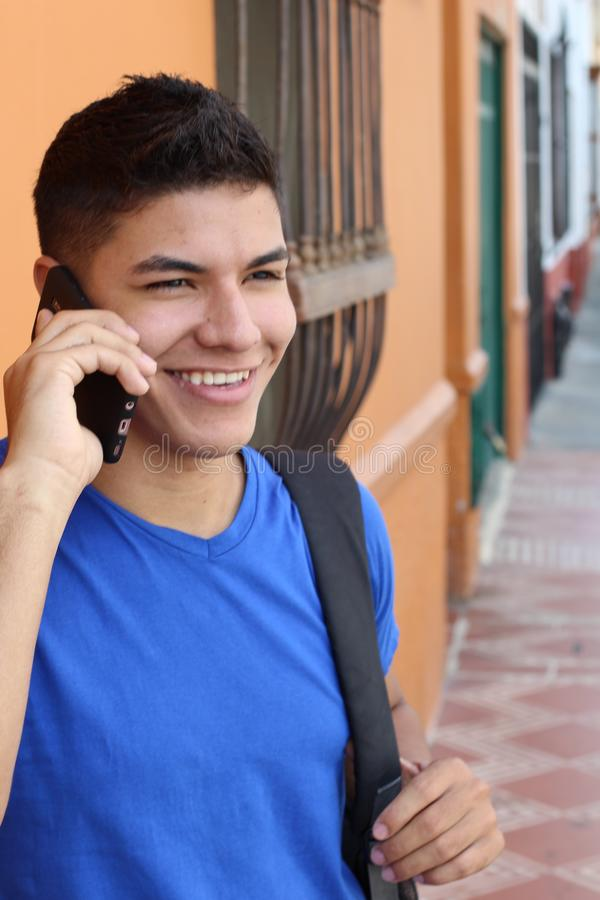 Young guy calling by phone outdoors royalty free stock photos