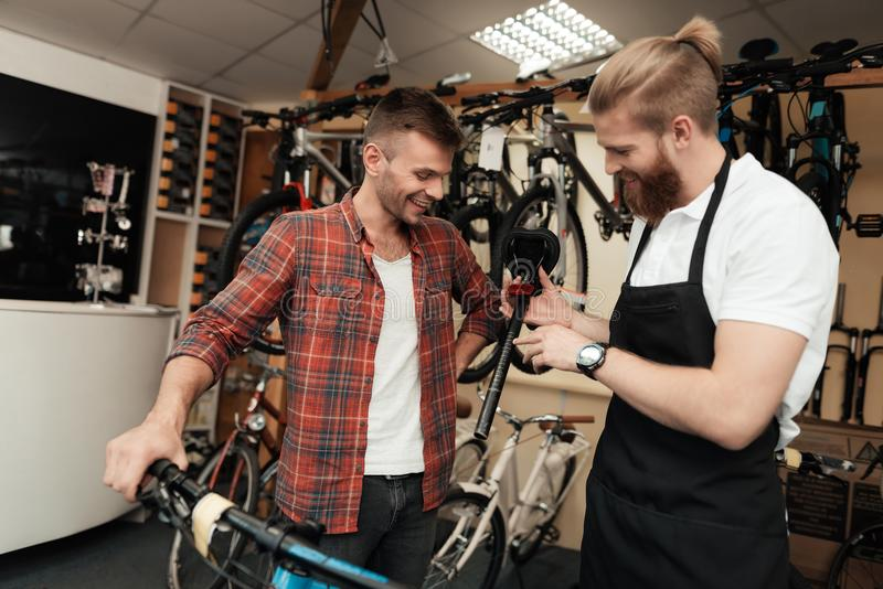 A young guy came to the workshop to repair his bicycle. royalty free stock images