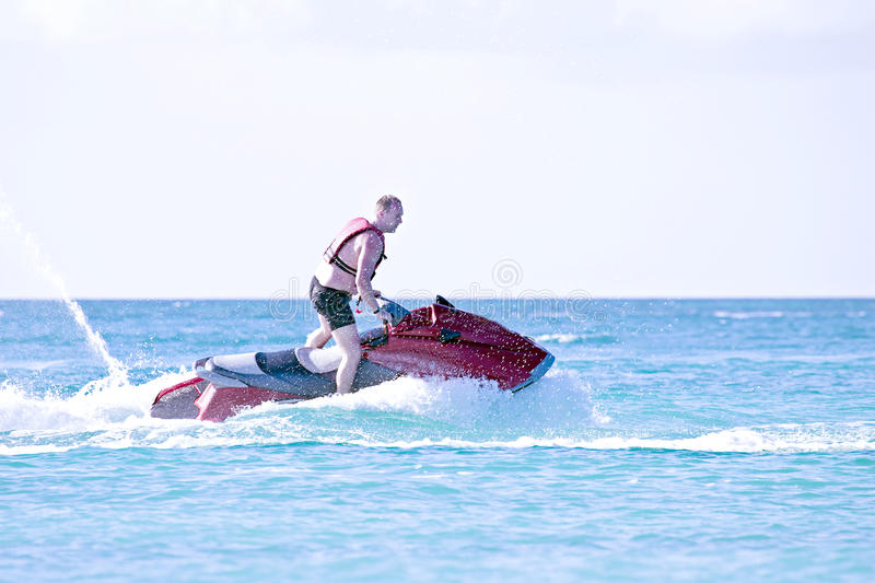 Download Young Guy Cruising On A Jet Ski Stock Photo - Image of shore, speed: 38291606
