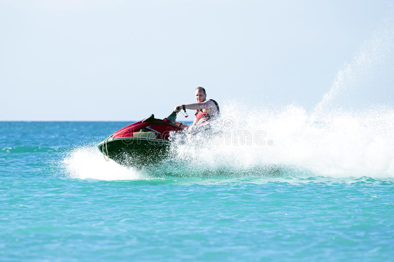 Download Young Guy Cruising On A Jet Ski Stock Image - Image: 38670389