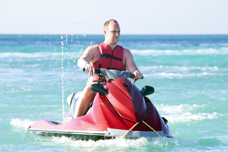 Download Young Guy Cruising On A Jet Ski Stock Photo - Image of rich, seasonal: 38670452