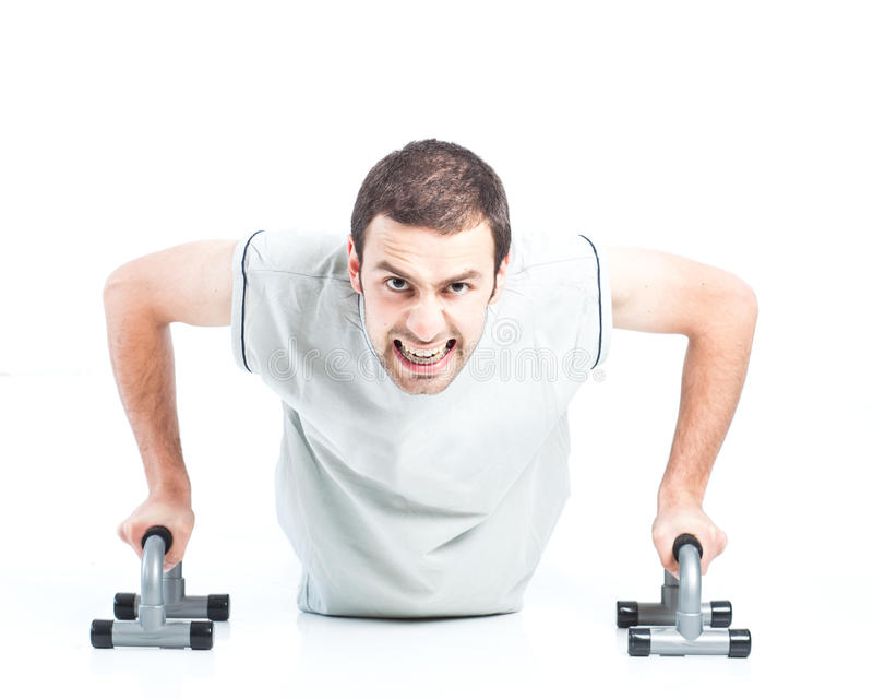 Download Young guy doing push ups stock photo. Image of exercise - 25970262