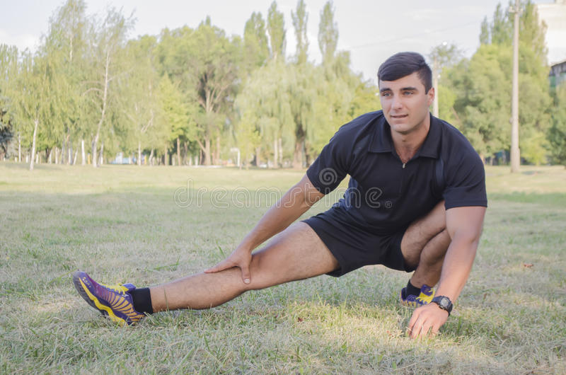 The young guy is engaged in fitness. In the open air stock image