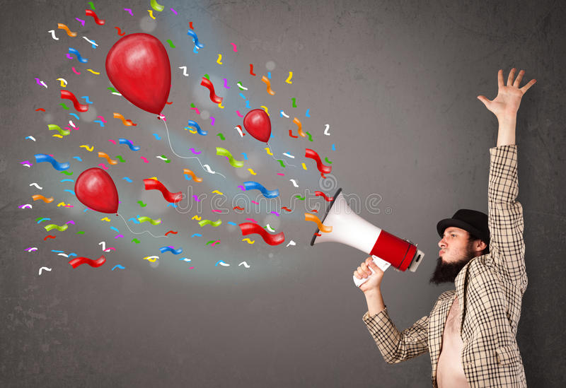 Download Young Guy Having Fun, Shouting Into Megaphone With Balloons Stock Photo - Image: 33303584