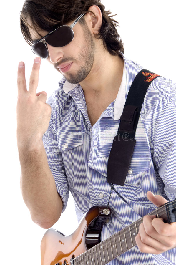 Download Young Guy Holding Guitar And Gesturing Stock Photo - Image: 7207428