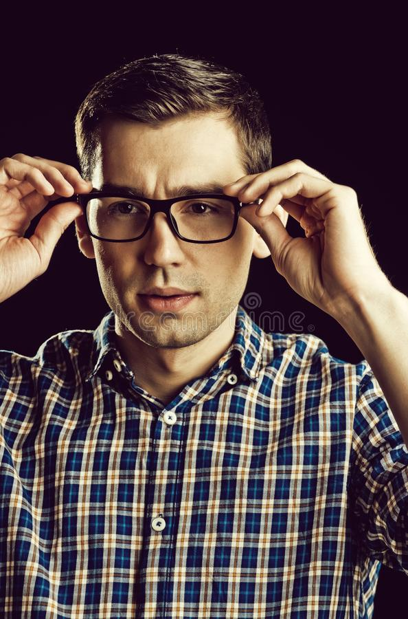 Young guy, nerd in glasses and fashionable checkered shirt stock image