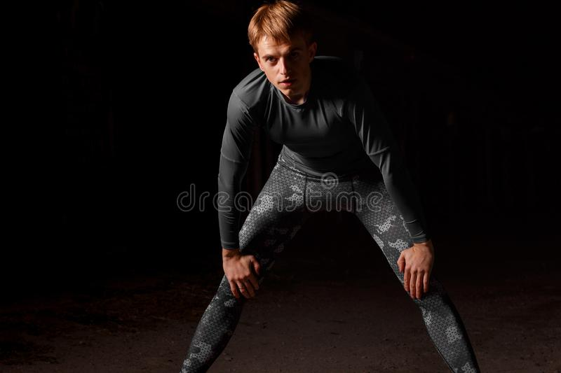 Young guy on a night workout in sportswear. Young guy on a night workout stock photography