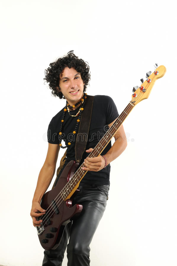 Young guy playing bass guitar. Portrait of young trendy man playing electric bass guitar isolated royalty free stock images