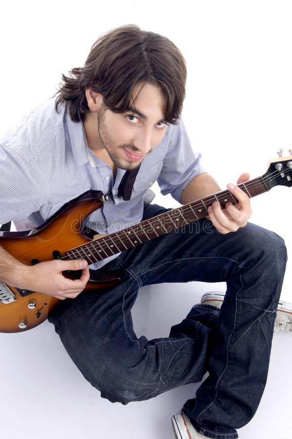 Download Young guy playing melody stock photo. Image of adult, musician - 6970254