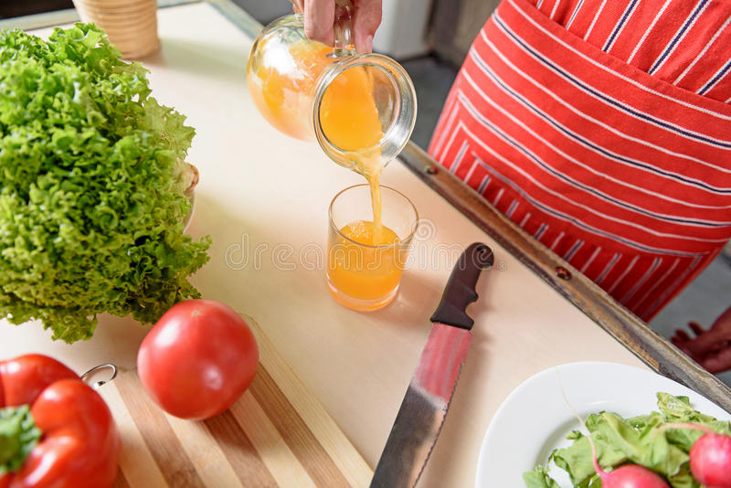 Young guy preparing healthy drink at home royalty free stock photos