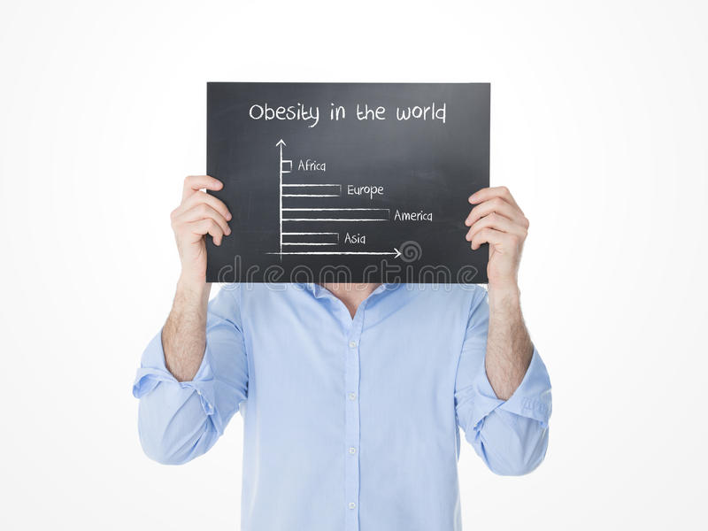 Young guy showing statics of obesity in the world royalty free stock photos