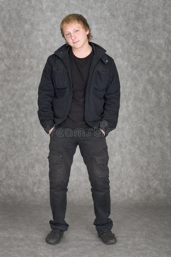 Download Young Guy Standing On A Grey Background Stock Image - Image: 10866339
