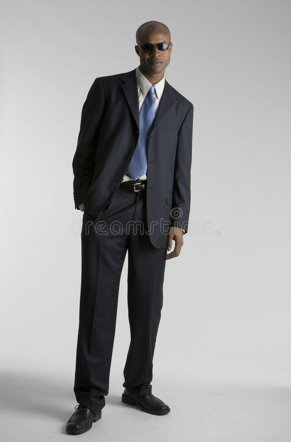 Young guy in a suit. Guy in a suit stock photography