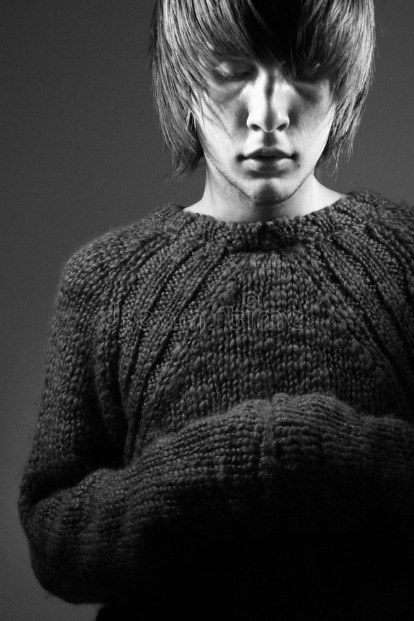 Young guy in a sweater royalty free stock images
