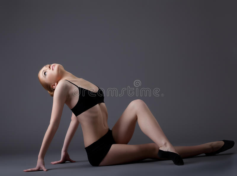 Young gymnast girl in black top look at light royalty free stock image