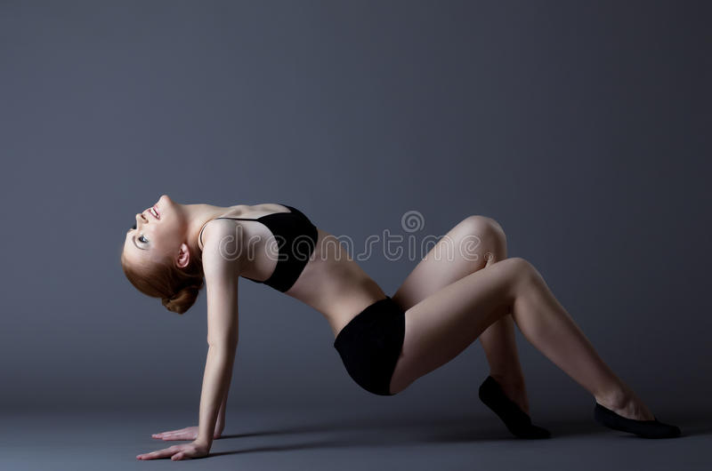 Download Young Gymnast Girl Posing In Black Top Stock Image - Image: 23808435