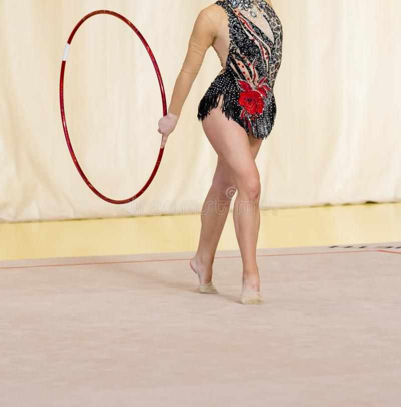 Young gymnast with red hoop artistic portrait .Flexibility in ac. Robatics and fitness health royalty free stock photography