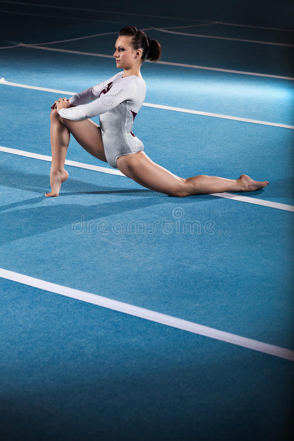 Download Young Gymnasts Competing In The Stadium Stock Photo - Image: 34849622