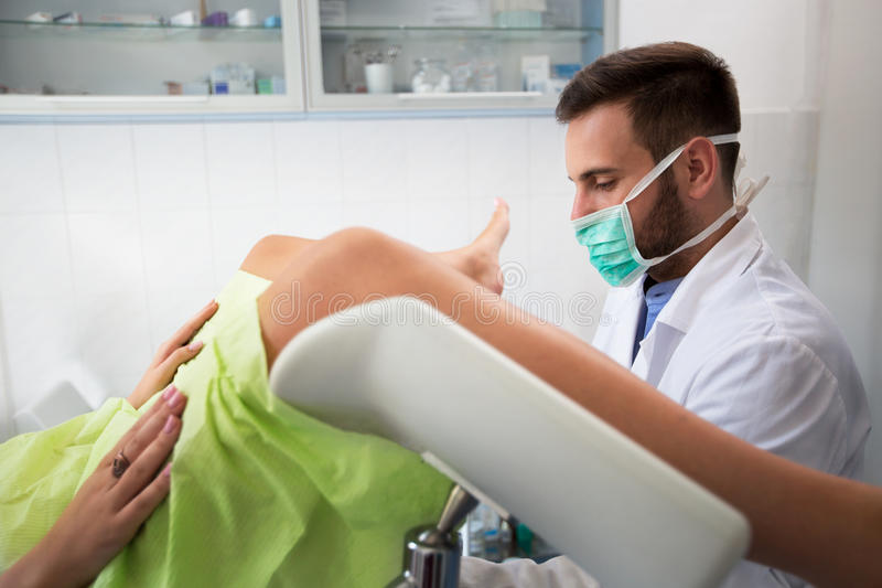 Young gynecologist exam his patient at clinic stock images