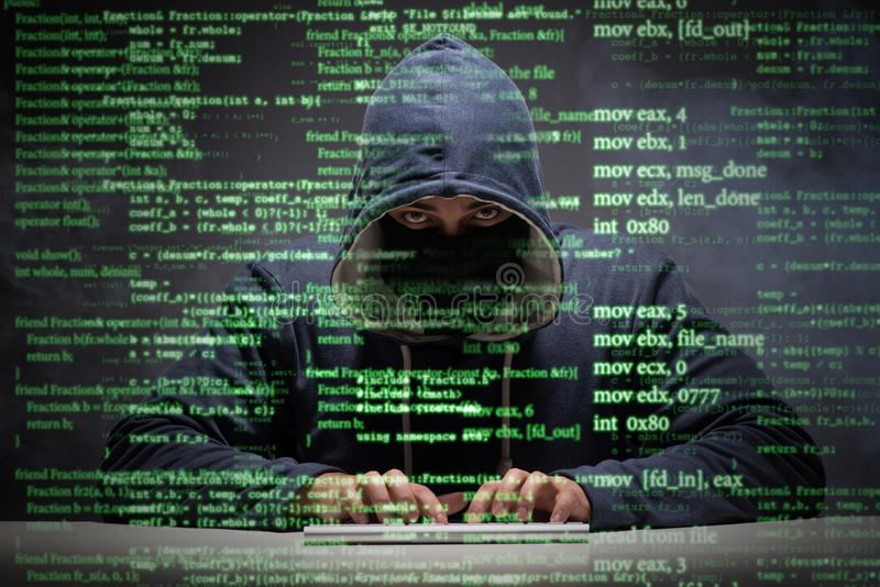 The young hacker in data security concept royalty free stock photography