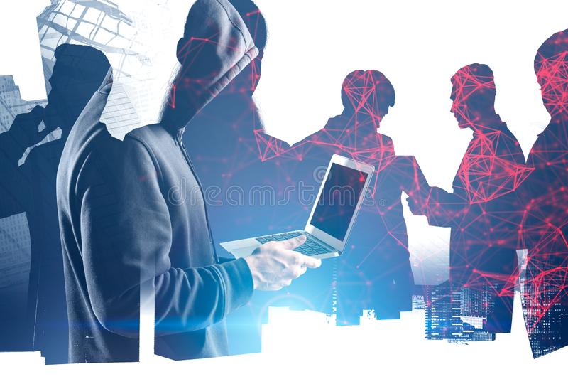 Hacker with laptop stealing business data stock photo