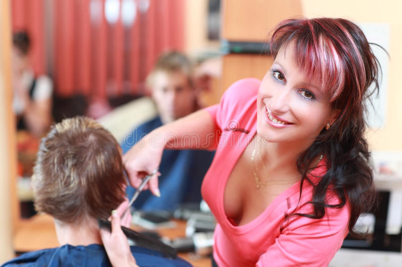 Young hairdresser royalty free stock photo