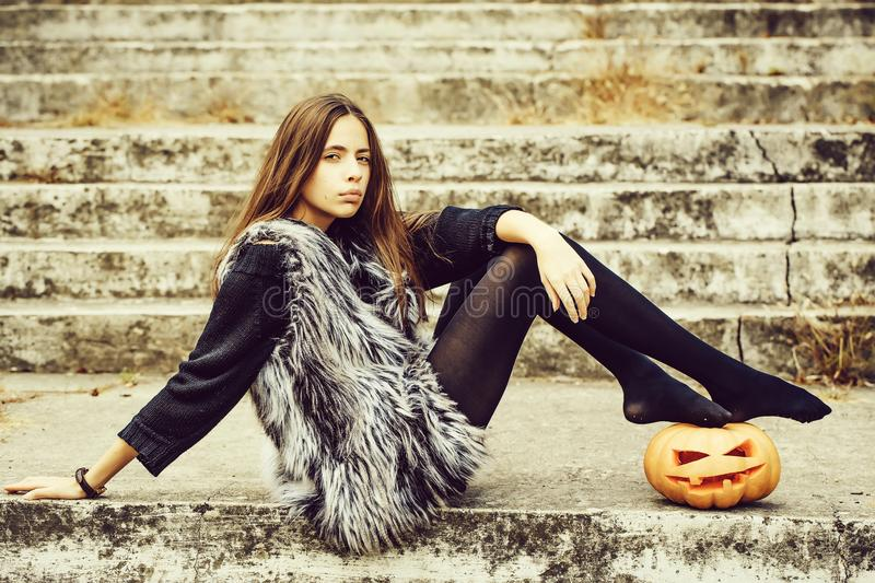 Halloween girl with pumpkin royalty free stock images