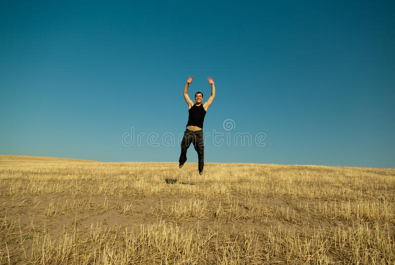 Young handsome asian man jumping stock photography
