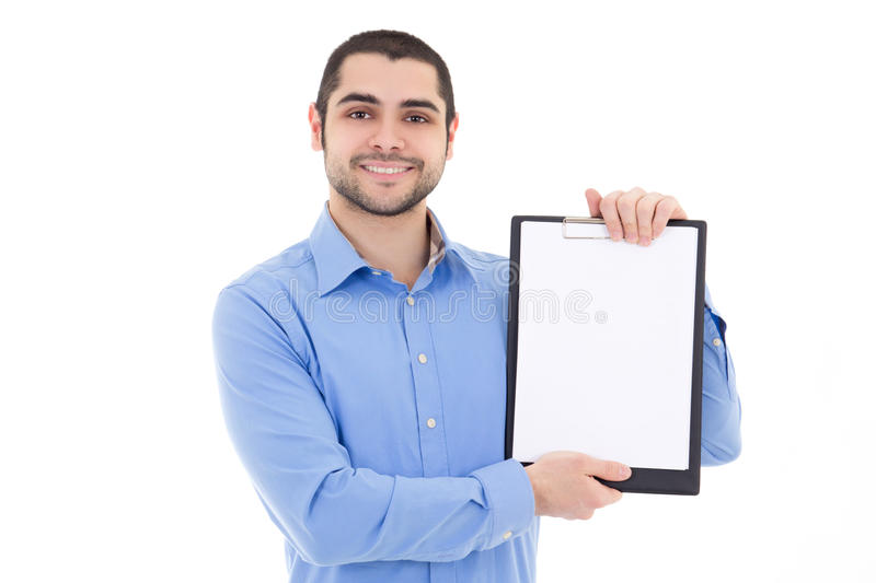 Young handsome bearded arabic man showing clipboard with copy sp stock image