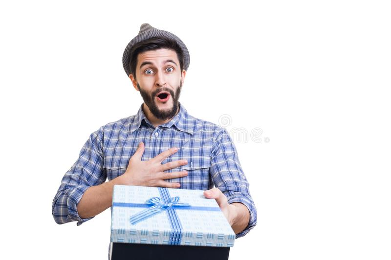 Bearded guy with gift. Young handsome bearded hipster holding gift box in hands royalty free stock photos