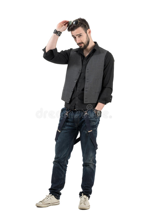 Young handsome bearded man putting sunglasses on his head royalty free stock photo